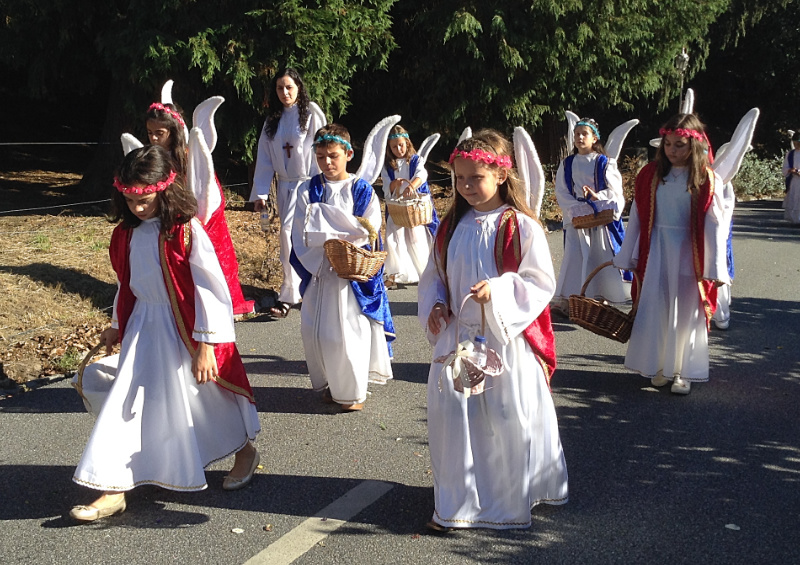 Little girls and boys dressed up as angels