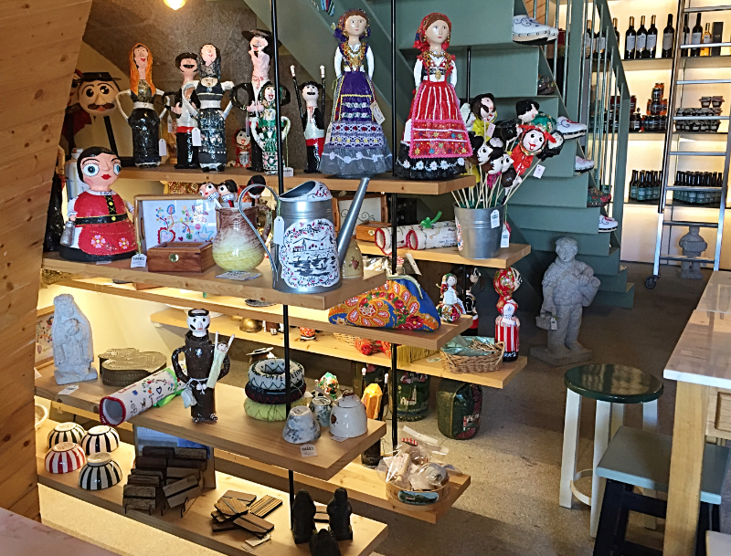 Dolls in traditional dress and pottery and