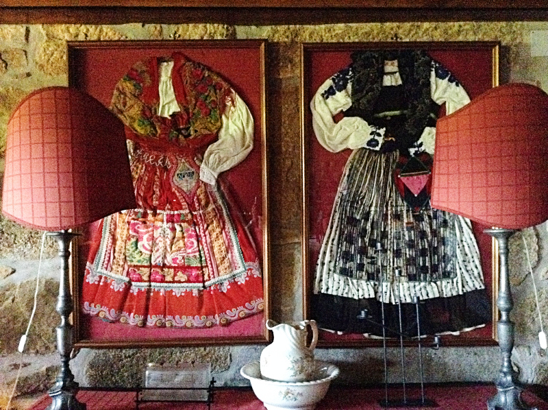 Framed traditional dresses in a local manor house