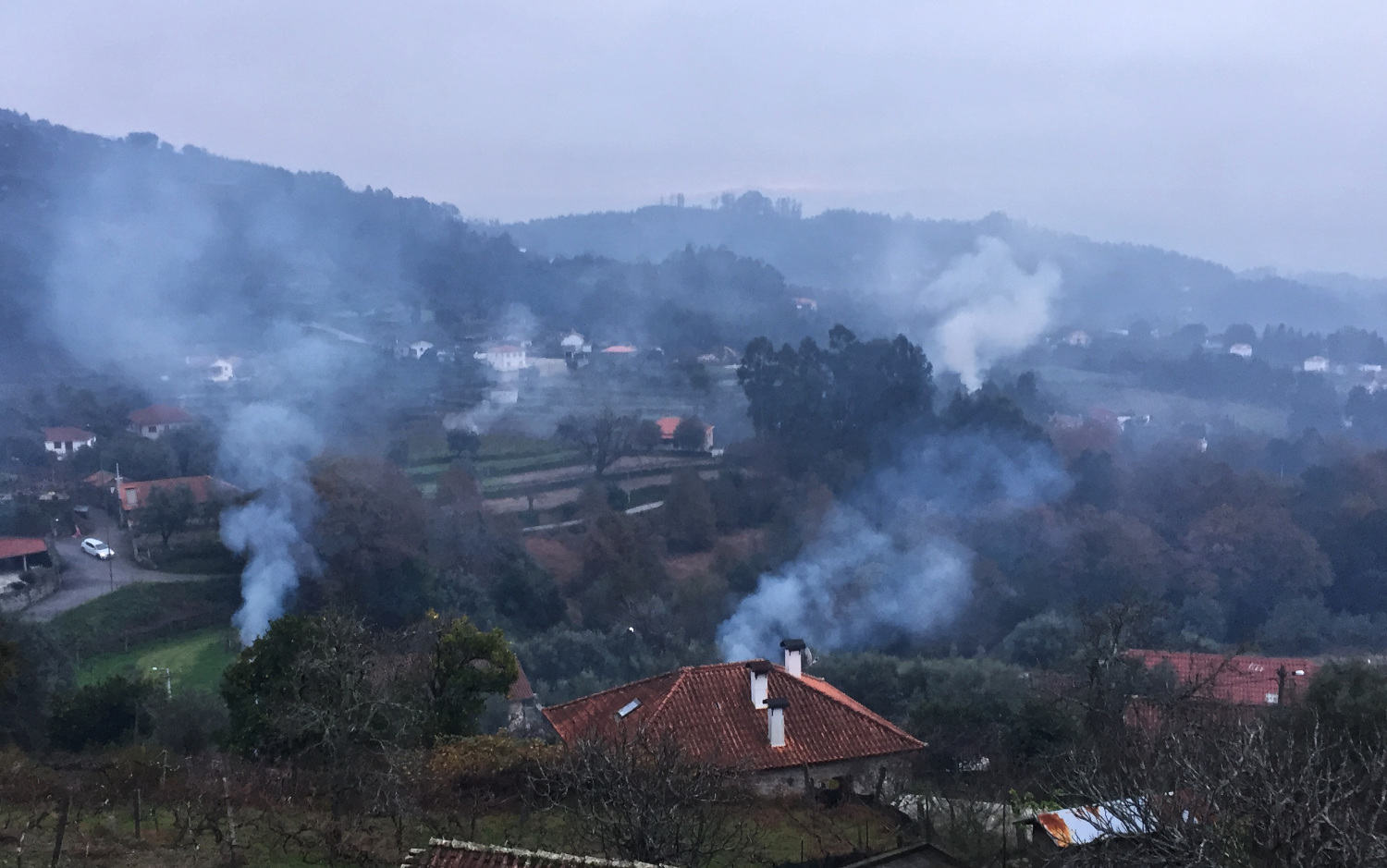 Smoke rises from the village of Esmorigo as people clear up after the harvest.