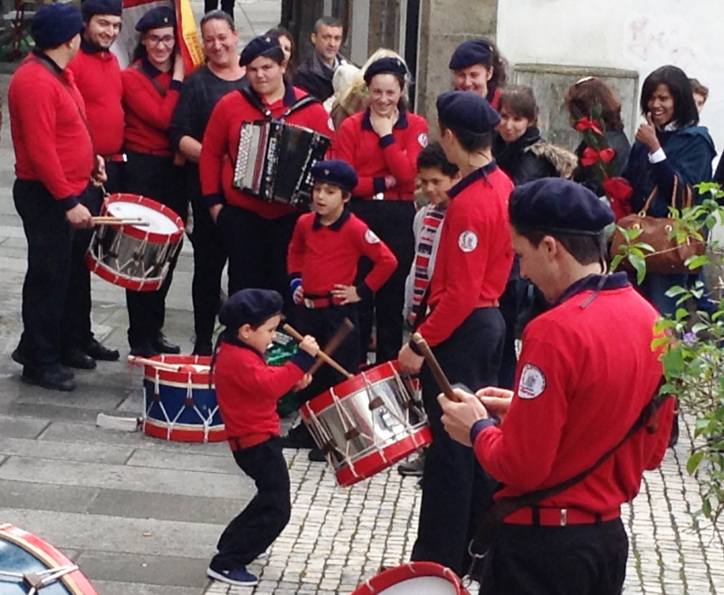 Very young drummer boy in the fire station grou[